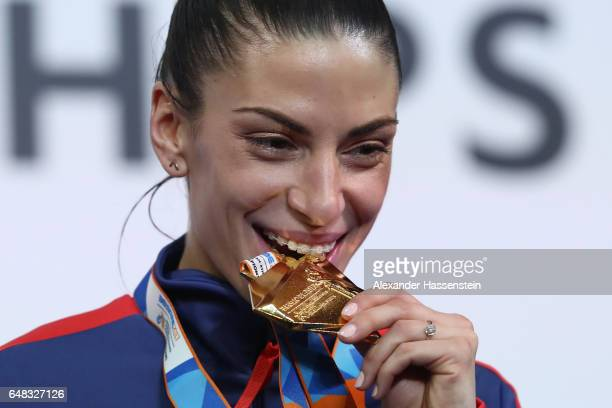 Gold medalist Ivana Spanovic of Serbia poses during the medal ceremony for the Women's Long Jump on day three of the 2017 European Athletics Indoor...
