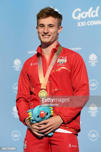 Gold medalist Jack Laugher of England poses during the medal ceremony for the Men's 3m Springboard Diving Final on day eight of the Gold Coast 2018...