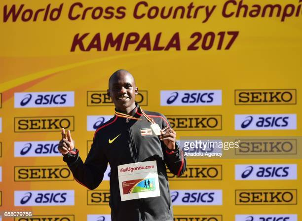 Gold medalist Jacob Kiplimo of Uganda poses at the stage after U20 men's race during the 27th World Cross Country Championships organized by...