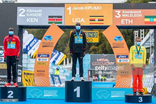 Gold medalist Jacob Kiplimo of Uganda silver Kibiwott Kandie of Kenya and bronze Amedework Walelegn of Ethiopia on the podium of 2020 IAAF World Half...