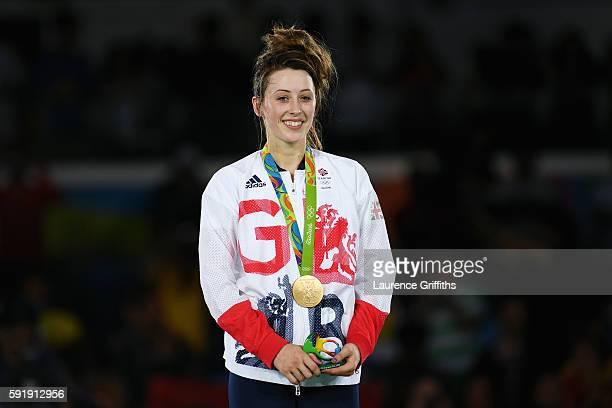 Gold medalist Jade Jones of Great Britain celebrates after defeating Eva Calvo Gomez of Spain during the Women's 57kg Gold Medal Taekwondo contest at...