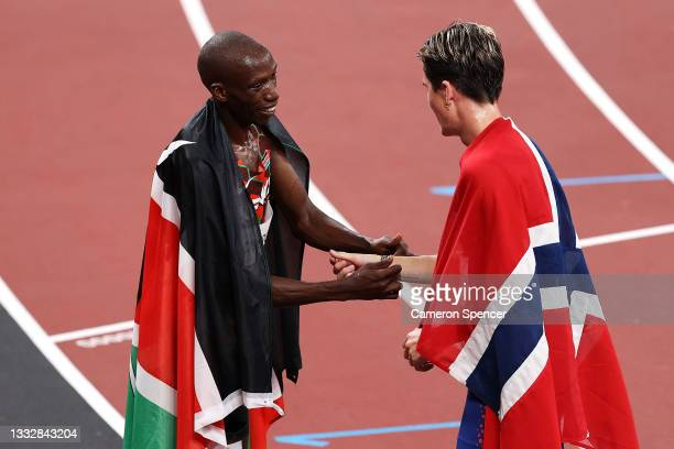 Gold medalist Jakob Ingebrigtsen of Team Norway and silver medalist Timothy Cheruiyot of Team Kenya interact after the Men's 1500m Final on day...
