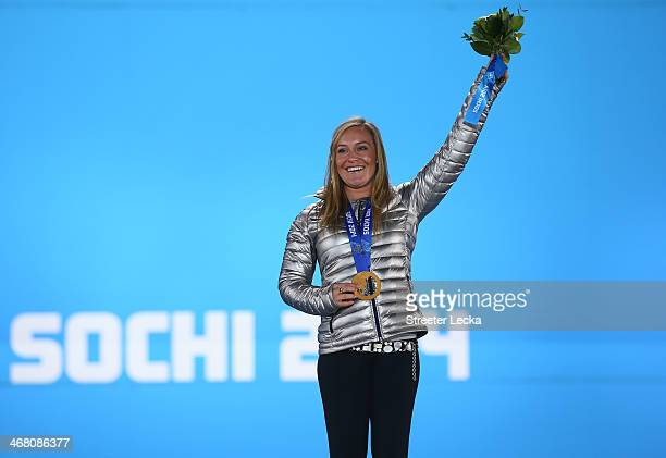 Gold medalist Jamie Anderson of the United States celebrates during the medal ceremony for the Women's Snowboard Slopestyle Finals on 2 of the Sochi...