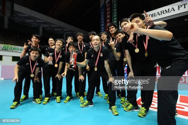 Gold medalist Japan celebrate on the podium during the 19th Asian Senior Men's Volleyball Championship awarding ceremony at GOR Tridharma on August...