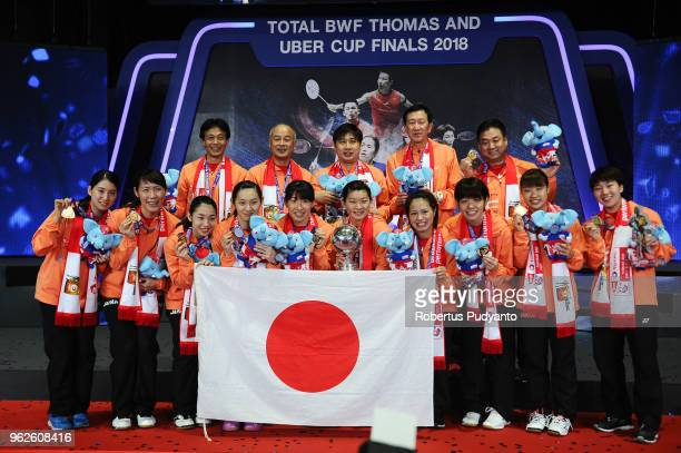 Gold medalist Japan celebrate on the podium during the awarding ceremony on day seven of the BWF Uber Cup at Impact Arena on May 26 2018 in Bangkok...