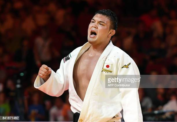 Gold medalist Japan's Aaron Wolf celebrates winning the mens 100kg category final fight at the World Judo Championships in Budapest on September 2...