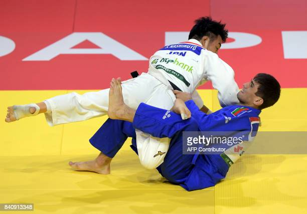 Gold medalist Japan's Soichi Hashimoto competes with Azerbaian's Rustam Orujov during their final in the mens 73kg category at the World Judo...