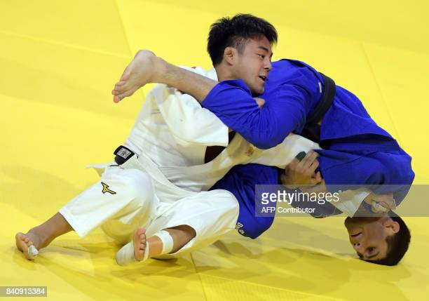 Gold medalist Japan's Soichi Hashimoto competes with Azerbaian's Rustam Orujov during their final in the mens -73kg category at the World Judo...