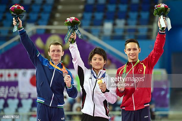 Gold medalist Japan's Yuya Kamoto poses with silver medalist Uzbekistan's Anton Fokin and bronze medalist Vietnam's Phuong Thanh Dinh during the...