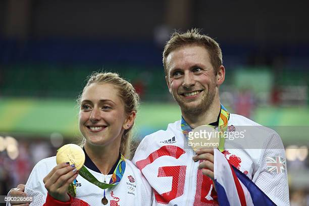Gold medalist Jason Kenny of Great Britain is joined by girlfriend cycling gold medalist Laura Trott of Great Britain during the medal ceremony after...