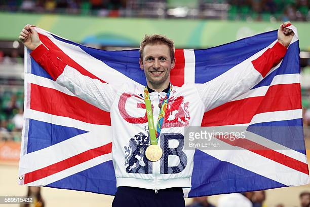 Gold medalist Jason Kenny of Great Britain poses for photographs after the medal ceremony for Men's Sprint on Day 9 of the Rio 2016 Olympic Games at...