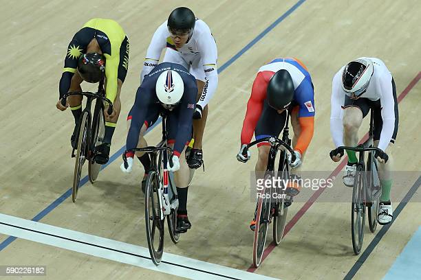 Gold medalist Jason Kenny of Great Britain silver medalist Matthijs Buchli of the Netherlands and bronze medalist Azizulhasni Awang of Malaysia cross...