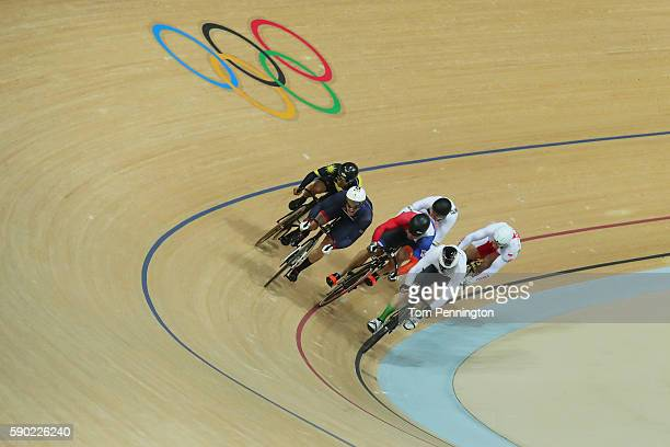 Gold medalist Jason Kenny of Great Britain, silver medalist Matthijs Buchli of the Netherlands and bronze medalist Azizulhasni Awang of Malaysia...