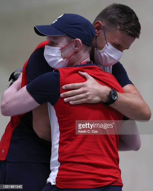 Gold Medalist Jean Quiquampoix of Team France celebrates with his coach following the 25m Rapid Fire Pistol Men's Finals on day ten of the Tokyo 2020...