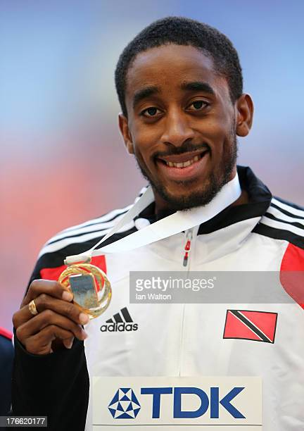 Gold medalist Jehue Gordon of Trinidad and Tobago poses on the podium during the medal ceremony for the Men's 400 metres Hurdles during Day Seven of...