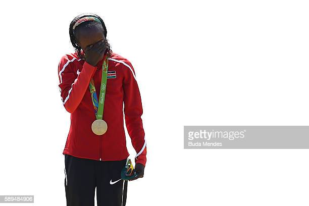 Gold medalist Jemima Jelagat Sumgong of Kenya reacts during the medal ceremony for the Women's Marathon on Day 9 of the Rio 2016 Olympic Games at the...