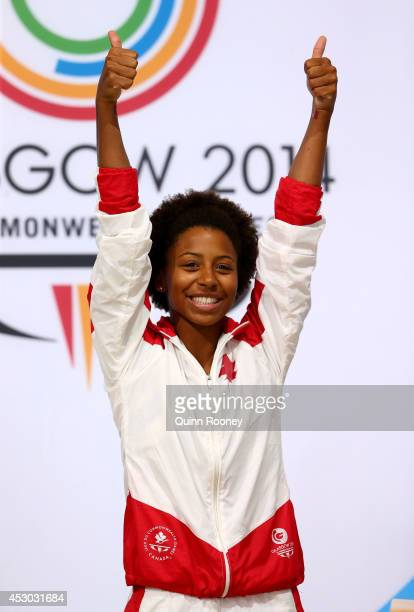Gold medalist Jennifer Abel of Canada celebrates during the medal ceremony for the Women's 1m Springboard Final at Royal Commonwealth Pool during day...