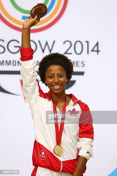 Gold medalist Jennifer Abel of Canada poses during the medal ceremony for the Women's 1m Springboard Final at Royal Commonwealth Pool during day nine...
