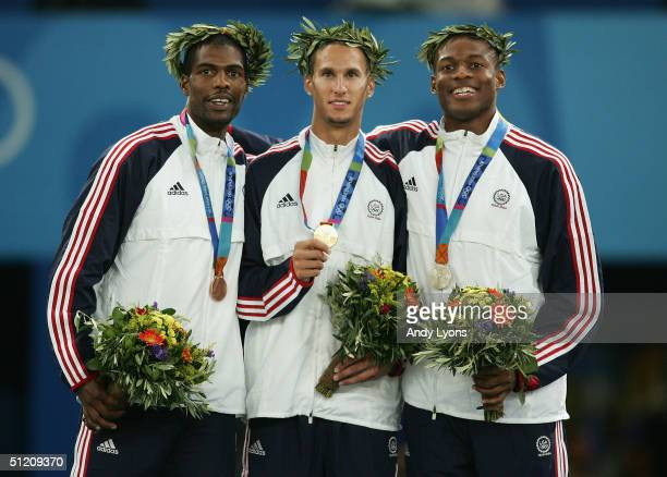 Gold medalist Jeremy Wariner of USA silver medalist Otis Harris of USA and bronze medalist Derrick Brew of USA celebrate on the podium during the...