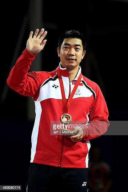 Gold medalist Jian Zhan of Singapore poses during the medal ceremony for the Men's Singles Gold Medal Match at Scotstoun Sports Campus during day ten...
