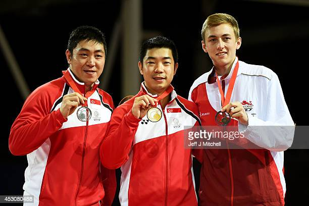 Gold medalist Jian Zhan of Singapore poses with silver medalist Ning Gao of Singapore of Singapore and bronze medalist Liam Pitchford of England...