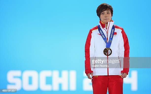 Gold medalist Jianrou Li of China celebrates during the medal ceremony for the Short Track Speed Skating Ladies' 500 m on day six of the Sochi 2014...