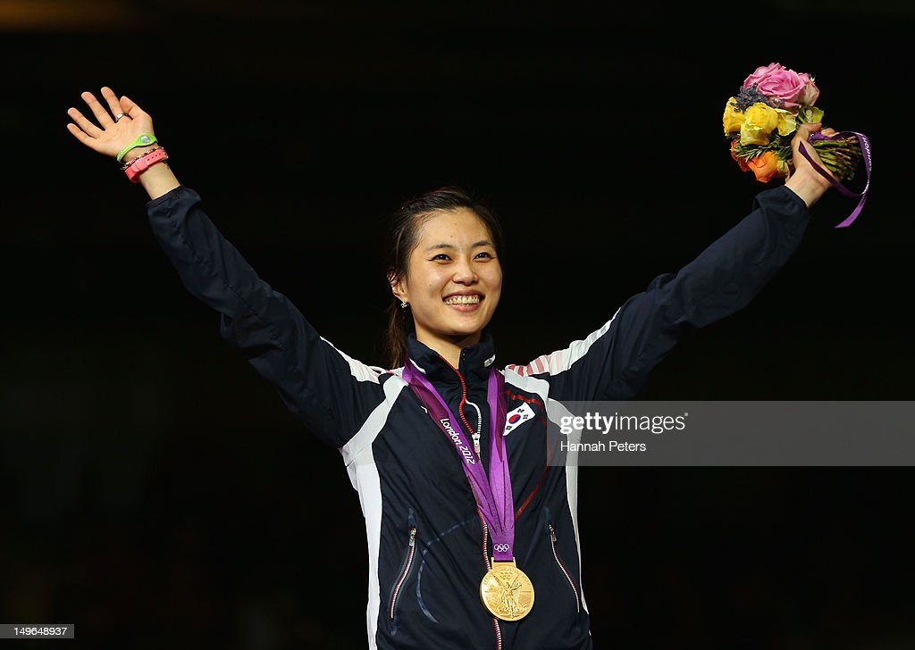 Gold medalist Jiyeon Kim of Korea poses on the podium during the medal ceremony in the Women's Sabre Individual Fencing Gold on Day 5 of the London 2012 Olympic Games at ExCeL on August 1, 2012 in London, England.