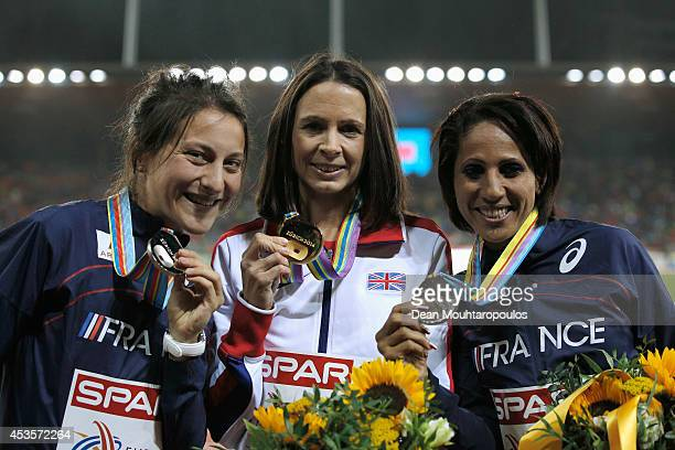 Gold medalist Jo Pavey of Great Britain and Northern Ireland poses next to Clemence Calvin of France and Laila Traby of France during the medal...
