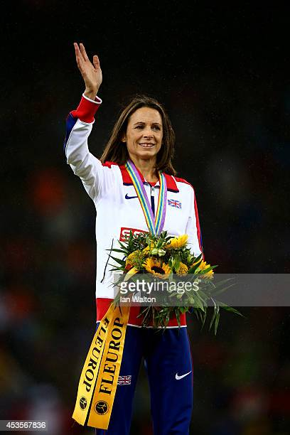 Gold medalist Jo Pavey of Great Britain and Northern Ireland waves to the crowd during the medal ceremony for the Women's 10000 metres final during...