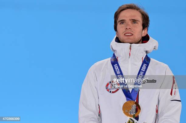 Gold medalist Joergen Graabak of Norway celebrates during the medal ceremony for the Nordic Combined Men's 10km Cross Country on day twelve of the...