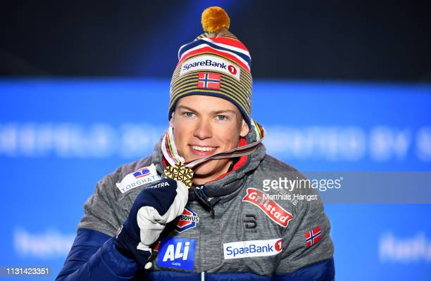 Gold medalist Johannes Hoesflot Klaebo of Norway celebrates during the medal ceremony for the Men's Cross Country Sprint at the Medal Plaza on...