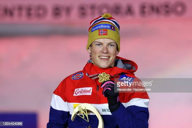 Gold medalist Johannes Hoesflot Klaebo of Norway celebrates during the medal ceremony for the Men's Cross Country SP C Final at the FIS Nordic World...