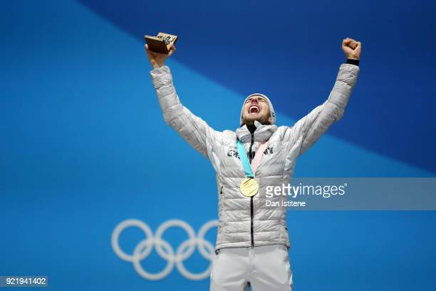 Gold medalist Johannes Rydzek of Germany celebrates during the medal ceremony for the Nordic Combined Individual Gundersen 10km Cross-Countryon day...