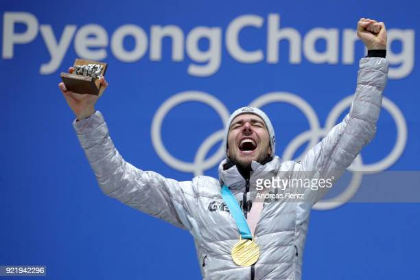 Gold medalist Johannes Rydzek of Germany celebrates during the medal ceremony for the Nordic Combined Individual Gundersen 10km CrossCountryon day...