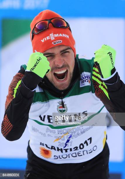 Gold medalist Johannes Rydzek of Germany celebrates folowing victory in the Men's Nordic Combined 10KM Cross Country during the FIS Nordic World Ski...
