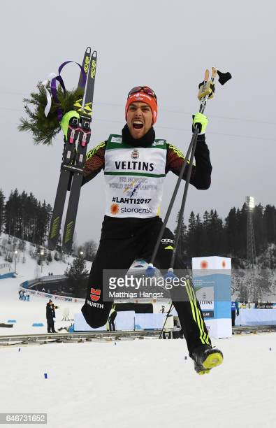 Gold medalist Johannes Rydzek of Germany celebrates victory in the Men's Nordic Combined 10KM Cross Country during the FIS Nordic World Ski...