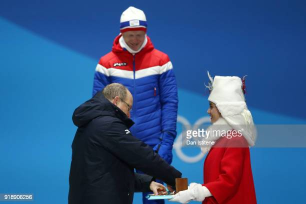 Gold medalist Johannes Thingnes Boe of Norway is presented his medal by Prince Albert II of Monaco during the Medal Ceremony for Biathlon Men's 20km...