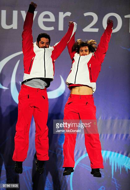 Gold medalist Jon Santacana Maiztegui of Spain and guide Miguel Galindo Garces celebrate during the medal ceremony for the Men's Visually Impaired...