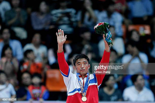 Gold medalist Jong Hakjin of North Korea celebrates during the medal ceremony after Wrestling Men's Freestyle 57 kg Gold Medal Final during day eight...