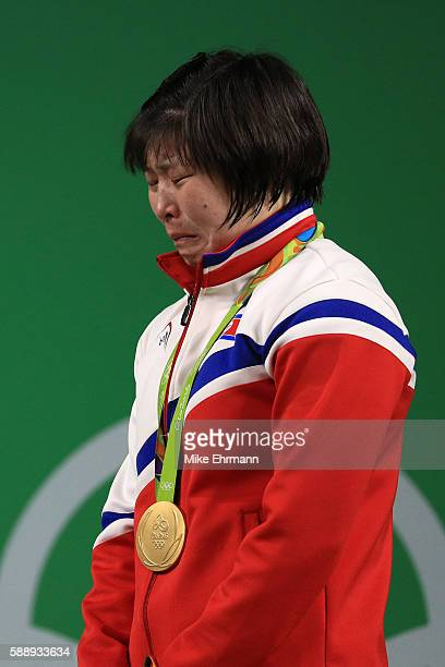 Gold medalist Jong Sim Rim of North Korea cries on the podium during the medal ceremony for the Weightlifting - Women's 75kg on Day 7 of the Rio 2016...