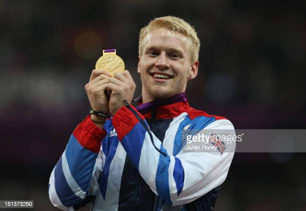 Gold medalist Jonnie Peacock of Great Britain poses on the podium during the victory ceremony for the Men's 100m T44 on day 8 of the London 2012...