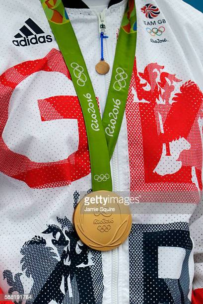 Gold medalist Joseph Clarke of Great Britain celebrates on the podium after winning the Kayak Men's Final on Day 5 of the Rio 2016 Olympic Games at...