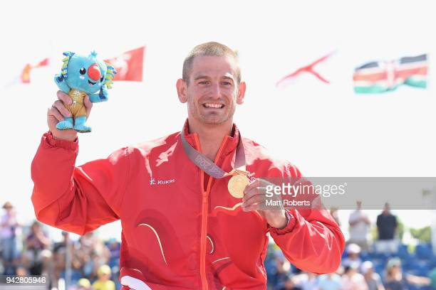 Gold medalist Joseph Townsend of England poses during the medal ceremony for the Triathlon Men's PTWC final on day three of the Gold Coast 2018...