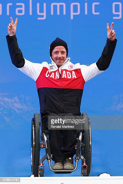 Gold medalist Josh Dueck of Canada celebrates at the medal ceremony for men's Super Combined Sitting on day eight of the Sochi 2014 Paralympic Winter...