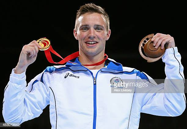 Gold medalist Josh Taylor of Scotland celebrates during the medal ceremony for the Men's Light Welter Final at SSE Hydro during day ten of the...