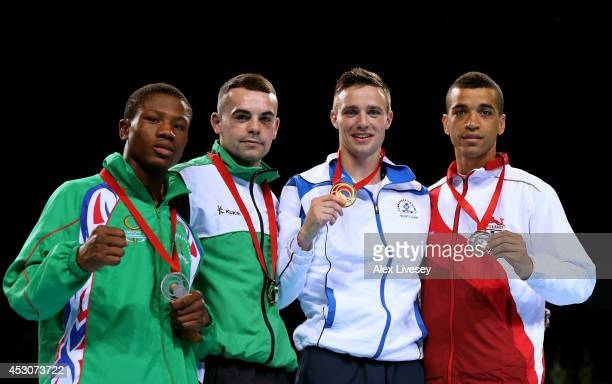 Gold medalist Josh Taylor of Scotland poses with silver medalist Junias Jonas of Namibia and bronze medalists Samuel Maxwell of England and Sean...