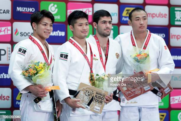 Gold medalist Joshiro Maruyama of Japan celebrates with silver medalist Hifumi Abe of Japan and bronze medalists Aram Grigoryan of Russia and Baskhuu...