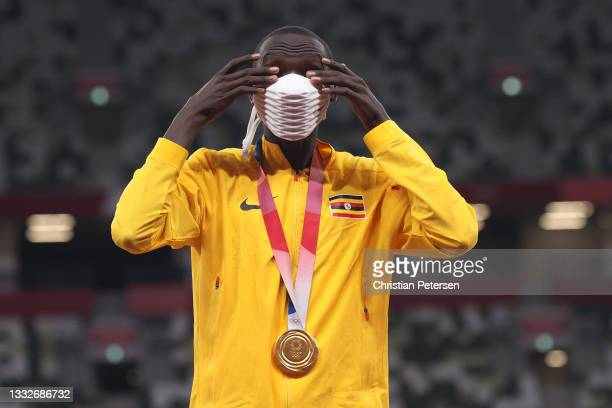 Gold medalist Joshua Cheptegei of Team Uganda stands on the podium during the medal ceremony for the Men's 5000m on day fourteen of the Tokyo 2020...