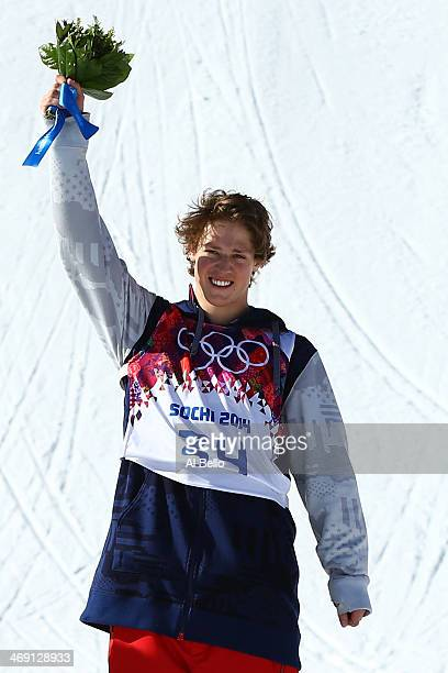 Gold medalist Joss Christensen of the United States stands on the podium during the flower ceremony after the Freestyle Skiing Men's Ski Slopestyle...