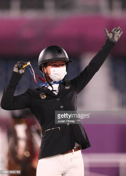 Gold medalist Julia Krajewski of Team Germany poses with the gold medal during the Eventing Individual Jumping medal ceremony on day ten of the Tokyo...